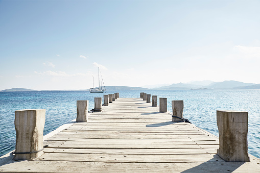 Mediterranean Sea「Empty jetty and saling boat in the background」:スマホ壁紙(10)