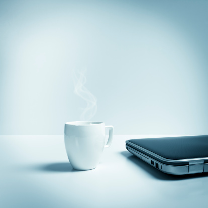 Breakfast「Closed laptop with mug of hot tea, coffee, blue toned」:スマホ壁紙(2)