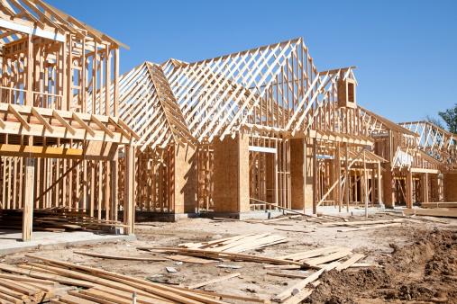 Home Ownership「New homes construction site. Framed houses. Lumber. Building.」:スマホ壁紙(8)