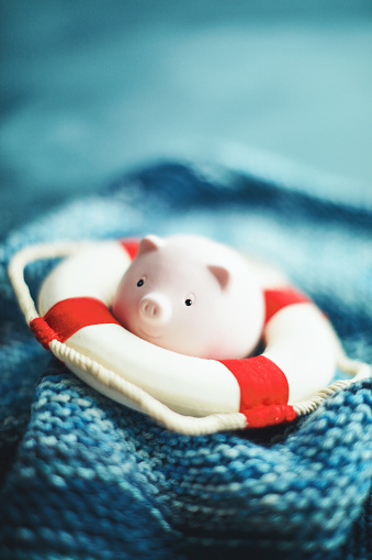 Insurance「Little pink piggy bank trying to stay afloat with life belt」:スマホ壁紙(8)