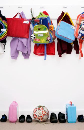Rack「Bags and coats hanging in children's cloakroom」:スマホ壁紙(9)
