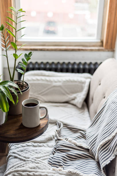 A comfortable sofa with coffee in a cozy home:スマホ壁紙(壁紙.com)