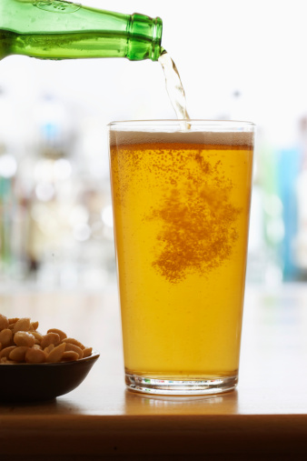 Focus On Foreground「Bottle of beer pouring into pint glass」:スマホ壁紙(12)