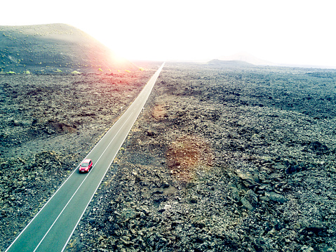 Volcanic Landscape「Aerial image of a car driving through a road in Lanzarote, Spain.」:スマホ壁紙(7)