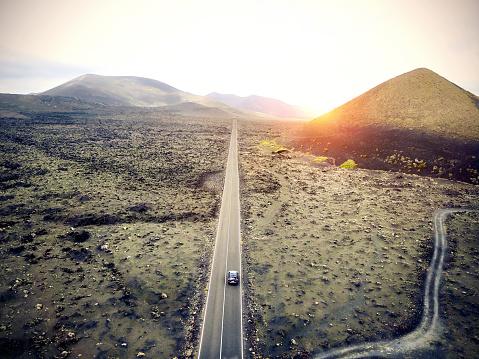Volcano「Aerial image of a car driving through a road in Lanzarote, Spain.」:スマホ壁紙(14)