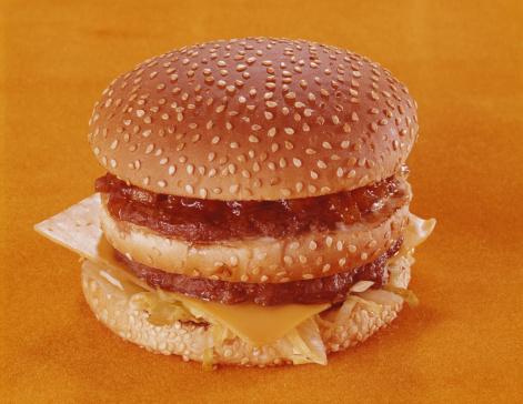 1969「Cheeseburger on orange background, close-up」:スマホ壁紙(16)