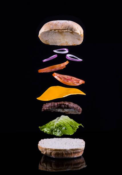Cheeseburger with ingredients mid-air:スマホ壁紙(壁紙.com)