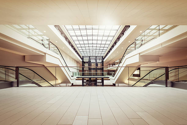 Escalators in a clean modern shopping mall:スマホ壁紙(壁紙.com)