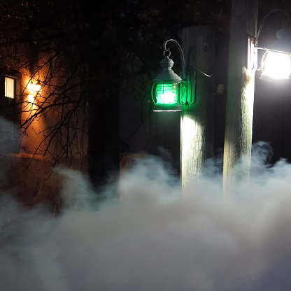 Wooden Post「Smoke and traditional outdoors green street light at haunted house in Halloween.」:スマホ壁紙(11)
