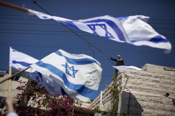 Patriotism「Israeli Settlers March Through Palestinian Neighbourhood Of East Jerusalem」:写真・画像(13)[壁紙.com]