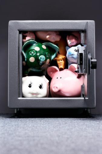 Focus On Background「Piggy banks crammed in safe, close-up」:スマホ壁紙(1)