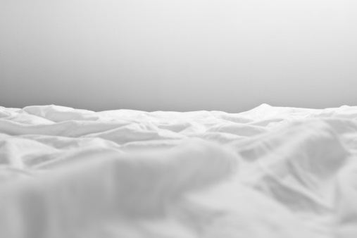 Gray Background「Crumpled sheets on a bed, close-up」:スマホ壁紙(17)