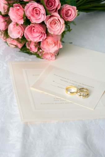 結婚「Bridal bouquet of pink roses with invitation and wedding rings」:スマホ壁紙(0)