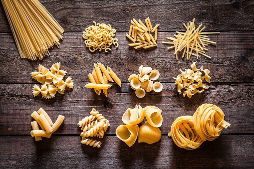 Homemade「Different types of Italian pasta on rustic wooden table」:スマホ壁紙(3)