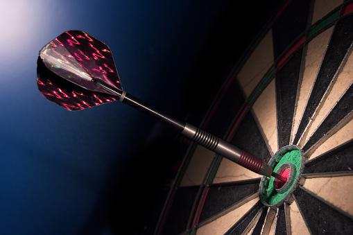 Sports Target「Dart resting in the bullseye of a dartboard, side shot」:スマホ壁紙(12)