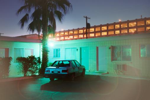 Motel「Single car at back of blue motel at night」:スマホ壁紙(8)