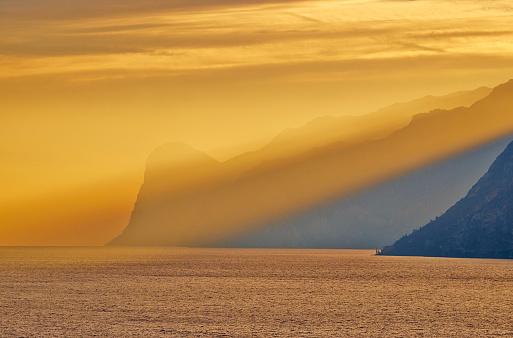 Spirituality「Italy, Torbole, Lake Garda with mountains at sunset」:スマホ壁紙(4)