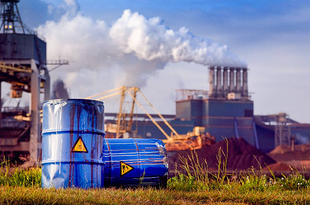 chemical waste drums in front of heavy industry:スマホ壁紙(壁紙.com)