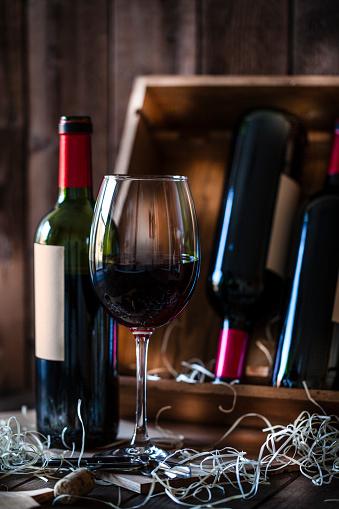 Wine Bottle「Wineglas and red wine bottle shot rustic wooden table」:スマホ壁紙(5)