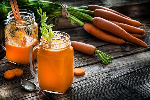Vegetable Juice「Healthy drink: carrot juice on rustic wooden table」:スマホ壁紙(3)