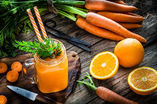 Vegetable Juice「Healthy drink: orange and carrot juice on rustic wooden table」:スマホ壁紙(15)