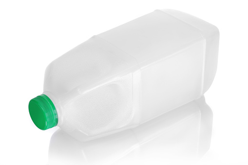 Bottle「Unlabeled milk jug laying on side with reflection on white」:スマホ壁紙(5)