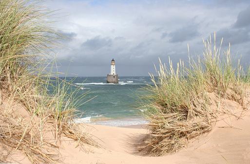 Timothy Grass「Scottish lightouse in sea on windy, stormy day」:スマホ壁紙(19)