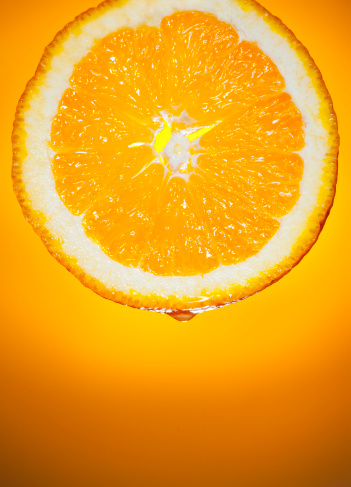 Gel Effect Lighting「Fresh  Orange Slice Dripping Fruit Juice on Sunrise Background」:スマホ壁紙(10)