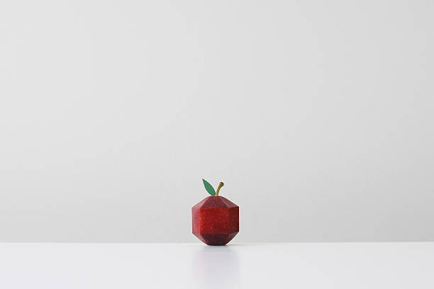 Red apple crafted into geometric shape imitating paper origami:スマホ壁紙(壁紙.com)