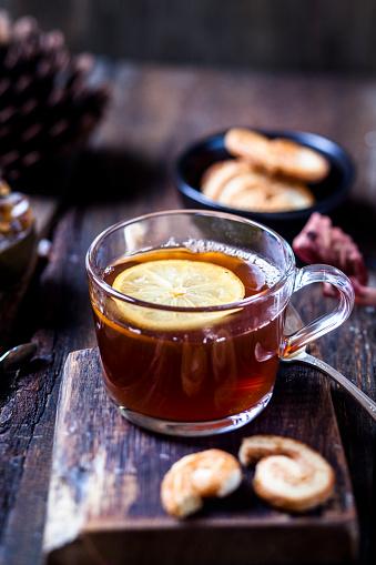 Animal Ear「Glass of black tea with slice of lemon and rock sugar on wooden table」:スマホ壁紙(11)