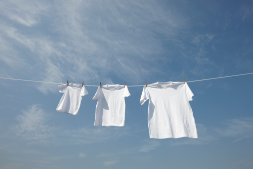 Laundry「White t-shirts in a row on washing line.」:スマホ壁紙(5)
