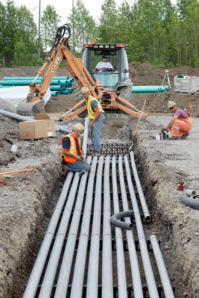 Finance and Economy「workers laying electrical conduit, backhoe, Tomlinson Construction; in progress; Road & Sewar Work; Algonquin College Trades centre; Ottawa; Ontario」:写真・画像(14)[壁紙.com]