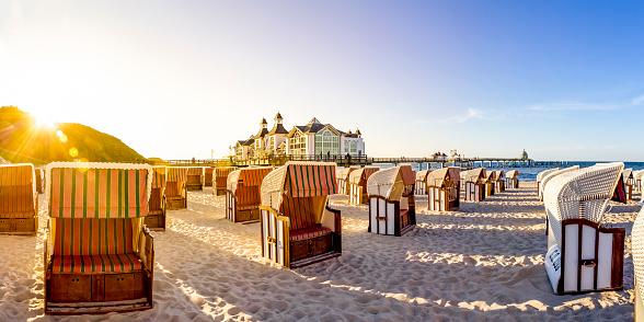Outdoor Chair「Germany, Mecklenburg-Western Pomerania, Ruegen, Sellin, Sea bridge and hooded beach chairs」:スマホ壁紙(6)