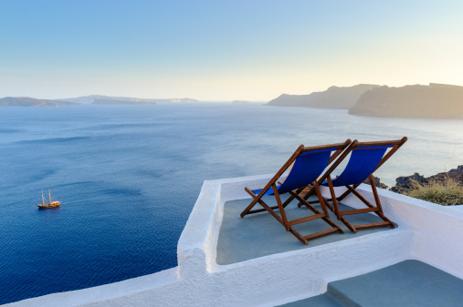 Aegean Sea「Two deck chairs with view, Santorini, Greece」:スマホ壁紙(7)