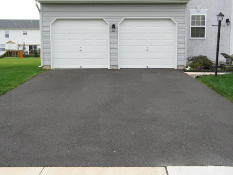 Front View「A double garage with white doors at the end of a driveway」:スマホ壁紙(10)