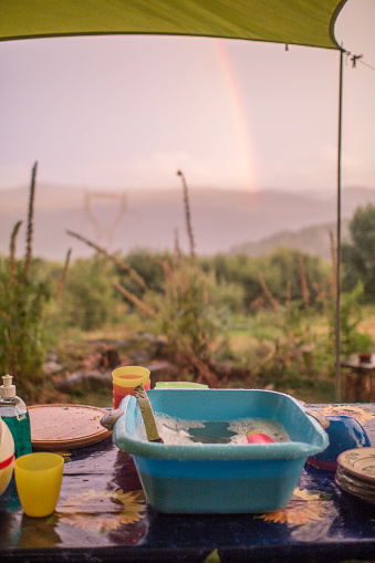 A Helping Hand「Doing the dishes on a remote camp site with view on mountains with a rainbow.」:スマホ壁紙(11)