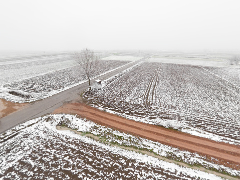 Plowed Field「Agriculture fields in valley covered with thin layer of snow in early springtime. Aerial view.」:スマホ壁紙(13)