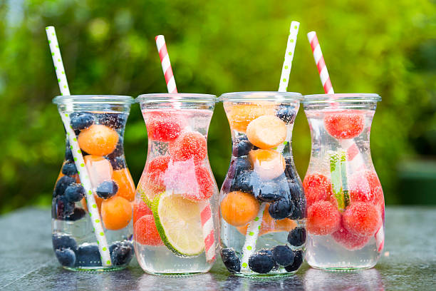 Carafes of miscellaneous fruit infused water:スマホ壁紙(壁紙.com)