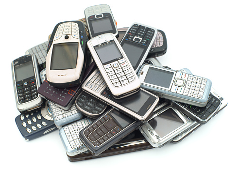 Mobile Phone「A pile of old used cellphones on a white background」:スマホ壁紙(11)