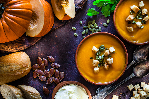 Recipe「Pumpkin soup with ingredients on rustic brown table. Top view」:スマホ壁紙(10)