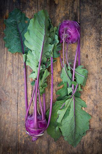 Crocus「Two blue turnip cabbages, Brassica oleracea var. gongylodes L. on dark wood, elevated view」:スマホ壁紙(9)
