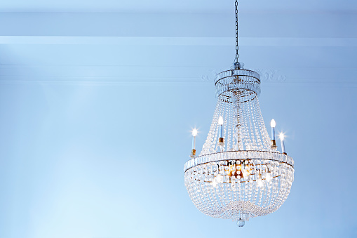 Austria「Lighted old ceiling lamp in front of light blue wall」:スマホ壁紙(5)