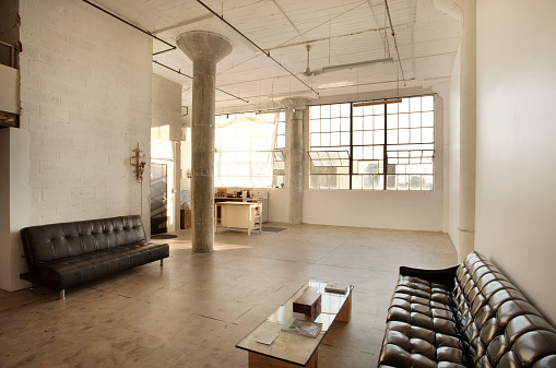 Industrial Building「Sofas in living room of loft」:スマホ壁紙(1)