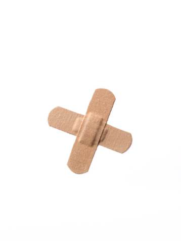 Healing「A stack of two adhesive plasters in shape of an X.」:スマホ壁紙(2)