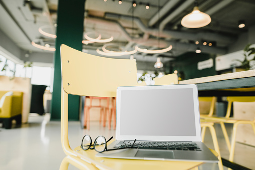 North Brabant「Business, Laptop and glasses on chair in coworking office」:スマホ壁紙(5)