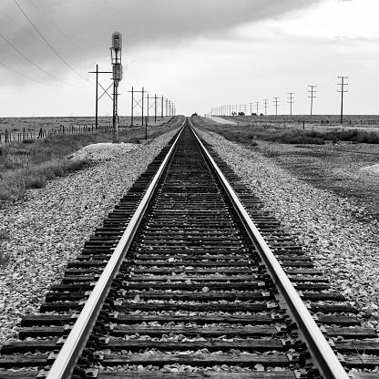 Escapism「This is a railroad track in Texas with a storm approaching in the background.」:スマホ壁紙(12)