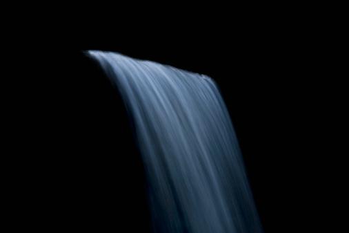 Flowing Water「waterfall against black background」:スマホ壁紙(17)