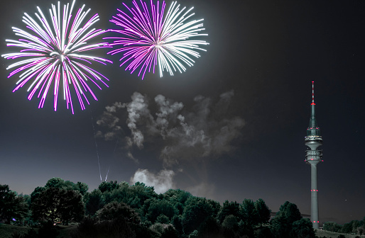 花火「spectacular, majestic fireworks display with colorful starburst explosives exploding in the night sky, rockets shot up bursting, glowing, sparkling and streaking lights during summer festival with Munich's Olympic TV Tower in background illuminated」:スマホ壁紙(7)