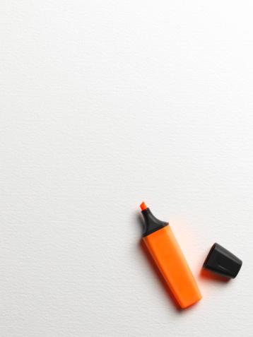 Pen「Orange highlight marker with lid on side, overhead view」:スマホ壁紙(10)