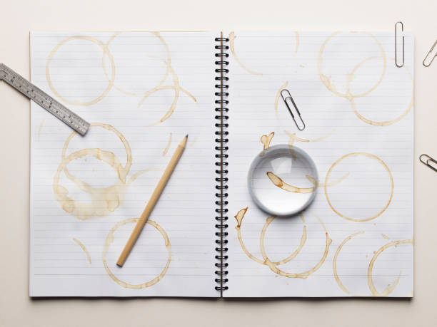 Notebook with empty coffee cup and lots of coffee stains:スマホ壁紙(壁紙.com)